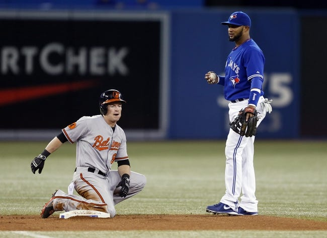 Jun 22, 2013; Toronto, Ontario, CAN; Baltimore Orioles left fielder Nate McLouth (9) breaks up the a double play attempt from Toronto Blue Jays second baseman Emilio Bonifacio (1) in the first inning at the Rogers Centre. Mandatory Credit: John E. Sokolowski-USA TODAY Sports