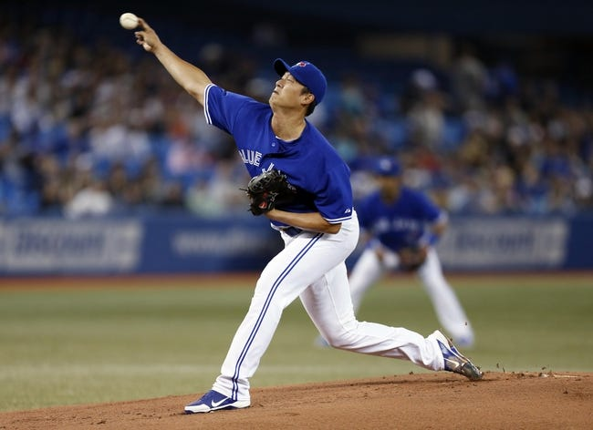 Jun 22, 2013; Toronto, Ontario, CAN; Toronto Blue Jays starting pitcher Chien-Ming Wang (67) throws against the Baltimore Orioles in the first inning at the Rogers Centre. Mandatory Credit: John E. Sokolowski-USA TODAY Sports