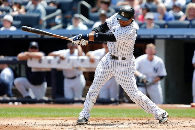Jun 22, 2013; Bronx, NY, USA;  New York Yankees second baseman Robinson Cano (24) singles to left during the third inning against the Tampa Bay Rays at Yankee Stadium.  Mandatory Credit: Anthony Gruppuso-USA TODAY Sports