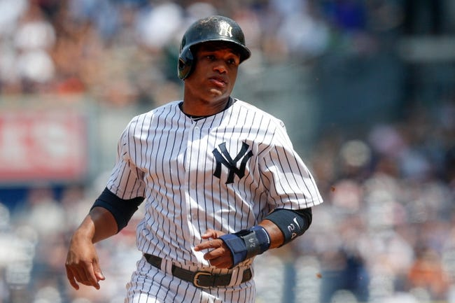 Jun 22, 2013; Bronx, NY, USA;  New York Yankees second baseman Robinson Cano (24) advances to third on a throwing error during the fifth inning against the Tampa Bay Rays at Yankee Stadium.  Mandatory Credit: Anthony Gruppuso-USA TODAY Sports