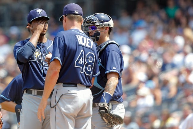 Jun 22, 2013; Bronx, NY, USA; Tampa Bay Rays pitching coach Jim Hickey (48) visits starting pitcher Alex Colome (37) during the fifth inning against the New York Yankees  at Yankee Stadium.  Mandatory Credit: Anthony Gruppuso-USA TODAY Sports