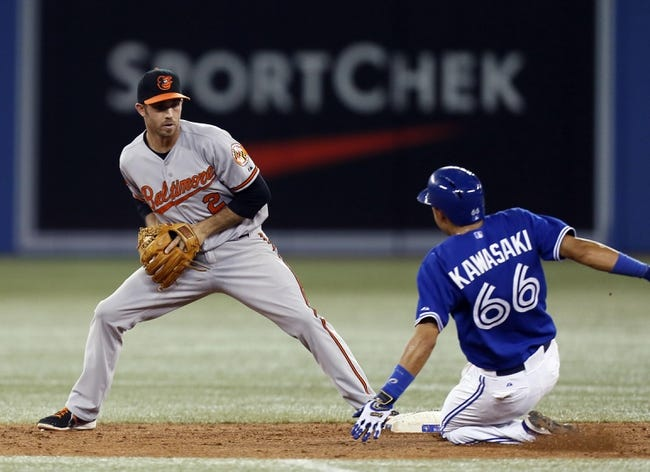 Jun 22, 2013; Toronto, Ontario, CAN; Baltimore Orioles shortstop J.J. Hardy (2) forces out Toronto Blue Jays shortstop Munenori Kawasaki (66) in the eighth inning at the Rogers Centre. Toronto defeated Baltimore 4-2. Mandatory Credit: John E. Sokolowski-USA TODAY Sports