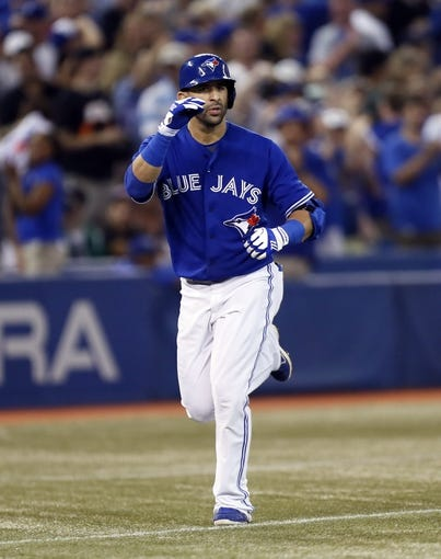 Jun 22, 2013; Toronto, Ontario, CAN; Toronto Blue Jays right fielder Jose Bautista (19) reacts after hitting a two-run home run in the eighth inning against the Baltimore Orioles at the Rogers Centre. Toronto defeated Baltimore 4-2. Mandatory Credit: John E. Sokolowski-USA TODAY Sports