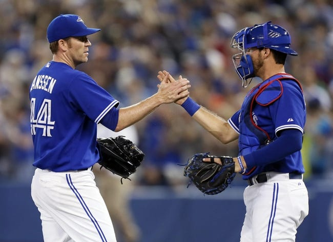 Jun 22, 2013; Toronto, Ontario, CAN; Toronto Blue Jays catcher J.P. Arencibia (right) congratulates releif pitcher Casey Janssen (44) after a win over the Baltimore Orioles at the Rogers Centre. Toronto defeated Baltimore 4-2. Mandatory Credit: John E. Sokolowski-USA TODAY Sports