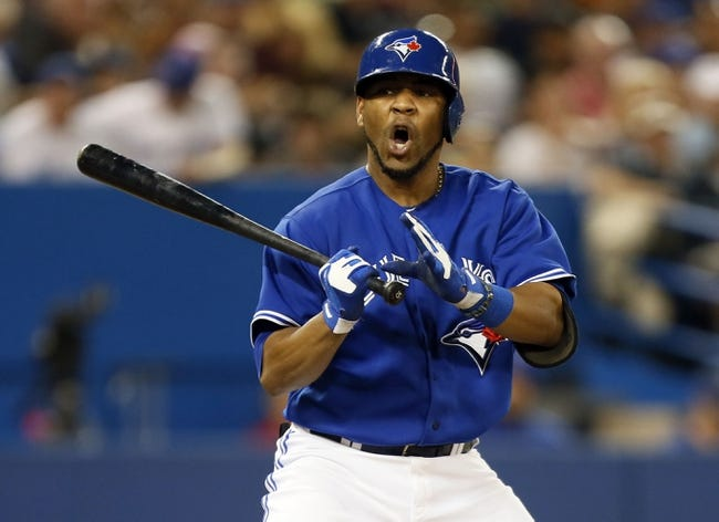 Jun 22, 2013; Toronto, Ontario, CAN; Toronto Blue Jays first baseman Edwin Encarnacion (10) reacts after a Baltimore Orioles pitch at the Rogers Centre. Toronto defeated Baltimore 4-2. Mandatory Credit: John E. Sokolowski-USA TODAY Sports