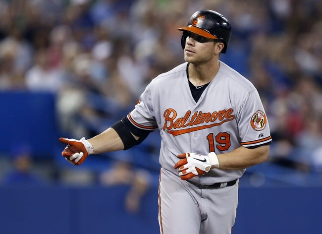 Jun 22, 2013; Toronto, Ontario, CAN; Baltimore Orioles designated hitter Chris Davis (19) goes to first after being hit by a Toronto Blue Jays pitch in the seventh inning at the Rogers Centre. Toronto defeated Baltimore 4-2. Mandatory Credit: John E. Sokolowski-USA TODAY Sports