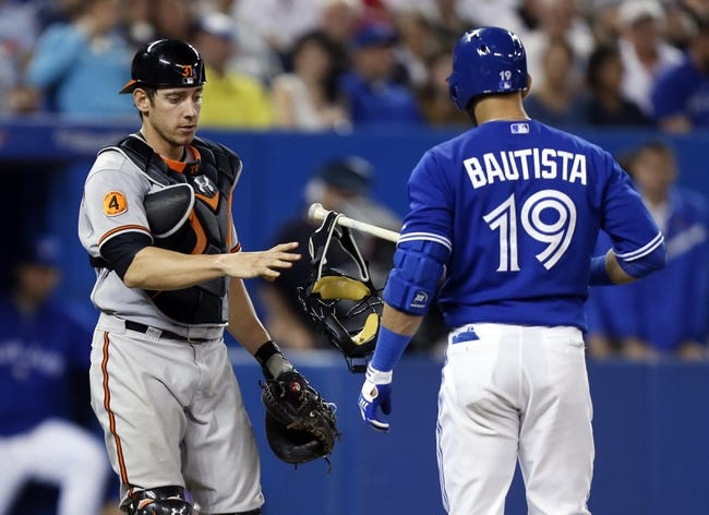 Jun 22, 2013; Toronto, Ontario, CAN; Toronto Blue Jays right fielder Jose Bautista (19) hands the catchers mask back to Baltimore Orioles catcher Taylor Teagarden (31) at the Rogers Centre. Toronto defeated Baltimore 4-2. Mandatory Credit: John E. Sokolowski-USA TODAY Sports
