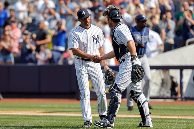 Jun 22, 2013; Bronx, NY, USA;  New York Yankees relief pitcher Mariano Rivera (42) and catcher Chris Stewart (19) celebrate the win against the Tampa Bay Rays at Yankee Stadium.  Yankees won 7-5.  Mandatory Credit: Anthony Gruppuso-USA TODAY Sports