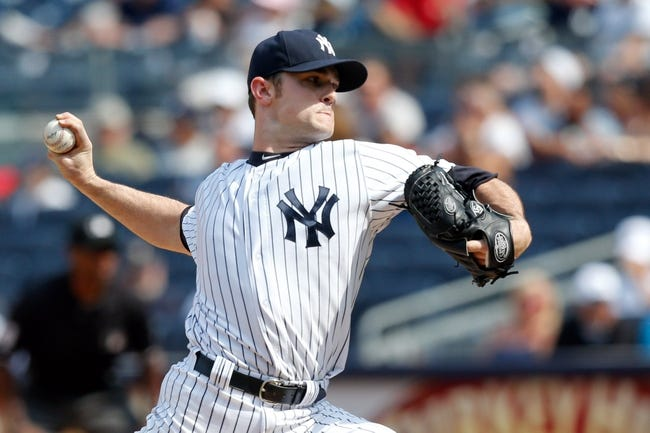 Jun 22, 2013; Bronx, NY, USA;  New York Yankees relief pitcher David Robertson (30) pitches during the eighth inning against the Tampa Bay Rays at Yankee Stadium.  Yankees won 7-5.  Mandatory Credit: Anthony Gruppuso-USA TODAY Sports