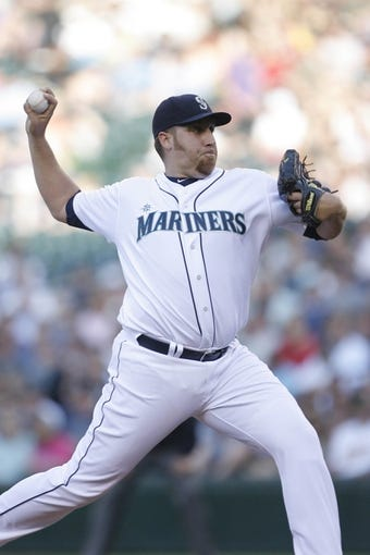 Jun 22, 2013; Seattle, WA, USA; Seattle Mariners pitcher Aaron Harang (39) throws against the Oakland Athletics during the first inning at Safeco Field. Mandatory Credit: Joe Nicholson-USA TODAY Sports