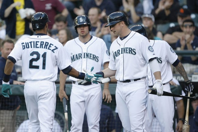 Jun 22, 2013; Seattle, WA, USA; Seattle Mariners center fielder Franklin Gutierez (21) is greeted at the dugout by first baseman Justin Smoak (17) after homering against the Oakland Athletics during the second inning at Safeco Field. Mandatory Credit: Joe Nicholson-USA TODAY Sports