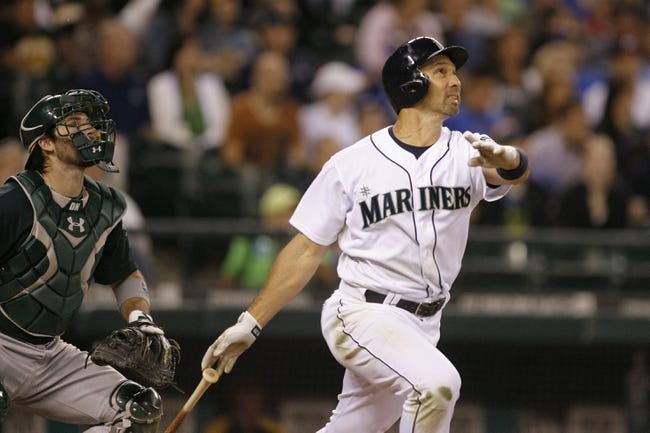 Jun 22, 2013; Seattle, WA, USA; Seattle Mariners left fielder Raul Ibanez (28) hits a three-run homer against the Oakland Athletics during the seventh inning at Safeco Field. Mandatory Credit: Joe Nicholson-USA TODAY Sports