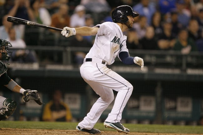 Jun 22, 2013; Seattle, WA, USA; Seattle Mariners second baseman Nick Franklin (20) hits a two-RBI single against the Oakland Athletics during the eighth inning at Safeco Field. Mandatory Credit: Joe Nicholson-USA TODAY Sports