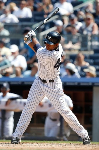 Jun 23, 2013; Bronx, NY, USA;  New York Yankees left fielder Zoilo Almonte (45) doubles to left during the fourth inning against the Tampa Bay Rays at Yankee Stadium.  Mandatory Credit: Anthony Gruppuso-USA TODAY Sports