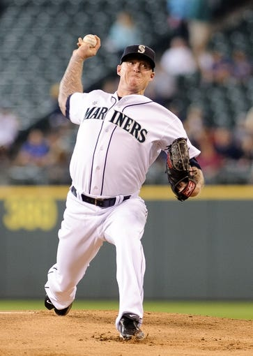 Jun 23, 2013; Seattle, WA, USA; Seattle Mariners starting pitcher Jeremy Bonderman (32) pitches to the Oakland Athletics during the 1st inning at Safeco Field. Mandatory Credit: Steven Bisig-USA TODAY Sports