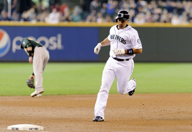 Jun 23, 2013; Seattle, WA, USA; Seattle Mariners designated hitter Raul Ibanez (28) rounds 3rd base after hitting a 2-run home run against the Oakland Athletics during the 1st inning at Safeco Field. Mandatory Credit: Steven Bisig-USA TODAY Sports