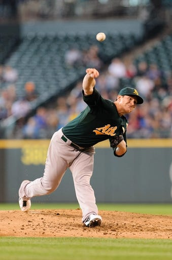 Jun 23, 2013; Seattle, WA, USA; Oakland Athletics starting pitcher Jarrod Parker (11) pitches to the Seattle Mariners during the 2nd inning at Safeco Field. Mandatory Credit: Steven Bisig-USA TODAY Sports