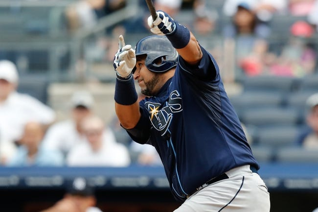 Jun 23, 2013; Bronx, NY, USA; Tampa Bay Rays catcher Jose Molina (28) singles to left center during the eighth inning against the New York Yankees at Yankee Stadium.  Tampa won 3-1.  Mandatory Credit: Anthony Gruppuso-USA TODAY Sports