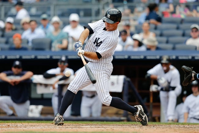 Jun 23, 2013; Bronx, NY, USA; New York Yankees center fielder Brett Gardner (11) singles to center during the seventh inning against the Tampa Bay Rays at Yankee Stadium.  Tampa won 3-1.  Mandatory Credit: Anthony Gruppuso-USA TODAY Sports