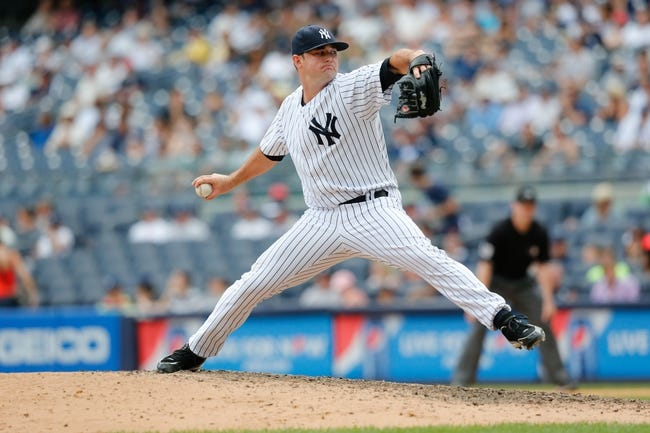 Jun 23, 2013; Bronx, NY, USA; New York Yankees relief pitcher Preston Claiborne (38) pitches during the ninth inning against the Tampa Bay Rays at Yankee Stadium.  Tampa won 3-1.  Mandatory Credit: Anthony Gruppuso-USA TODAY Sports