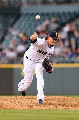 uJun 23, 2013; Seattle, WA, USA; Seattle Mariners relief pitcher Danny Farquhar (40) pitches to the Oakland Athletics during the 7th inning at Safeco Field. Mandatory Credit: Steven Bisig-USA TODAY Sports