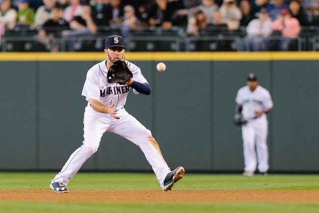 Jun 23, 2013; Seattle, WA, USA; Seattle Mariners second baseman Nick Franklin (20) fields a ground ball during the 7th inning against the Oakland Athletics at Safeco Field. Mandatory Credit: Steven Bisig-USA TODAY Sports