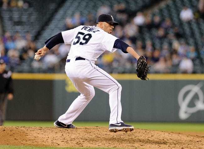 Jun 23, 2013; Seattle, WA, USA; Seattle Mariners relief pitcher Oliver Perez (59) pitches to the Oakland Athletics during the 9th inning at Safeco Field. Mandatory Credit: Steven Bisig-USA TODAY Sports