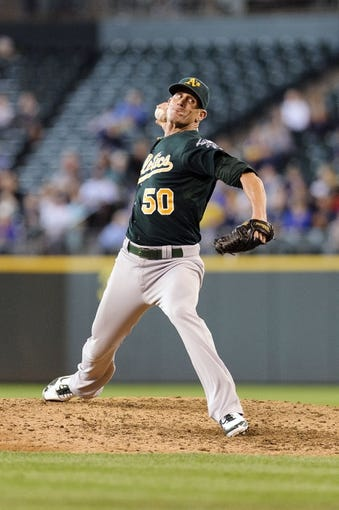 Jun 23, 2013; Seattle, WA, USA; Oakland Athletics relief pitcher Grant Balfour (50) pitches to the Seattle Mariners during the 10th inning at Safeco Field. Seattle defeated Oakland 6-3. Mandatory Credit: Steven Bisig-USA TODAY Sports