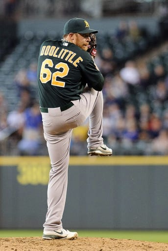 Jun 23, 2013; Seattle, WA, USA; Oakland Athletics relief pitcher Sean Doolittle (62) pitches to the Seattle Mariners during the 9th inning at Safeco Field. Seattle defeated Oakland 6-3. Mandatory Credit: Steven Bisig-USA TODAY Sports