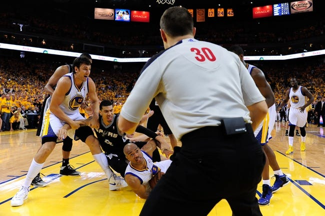 May 12, 2013; Oakland, CA, USA; Golden State Warriors point guard Jarrett Jack (2) looks at referee John Goble (30) during the fourth quarter in game four of the second round of the 2013 NBA Playoffs against San Antonio Spurs shooting guard Danny Green (4) at Oracle Arena. The Warriors defeated the Spurs 97-87 in overtime. Mandatory Credit: Kyle Terada-USA TODAY Sports