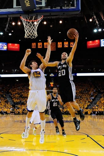 May 12, 2013; Oakland, CA, USA; San Antonio Spurs shooting guard Manu Ginobili (20) shoots the ball against Golden State Warriors center Andrew Bogut (12) during the fourth quarter in game four of the second round of the 2013 NBA Playoffs at Oracle Arena. The Warriors defeated the Spurs 97-87 in overtime. Mandatory Credit: Kyle Terada-USA TODAY Sports