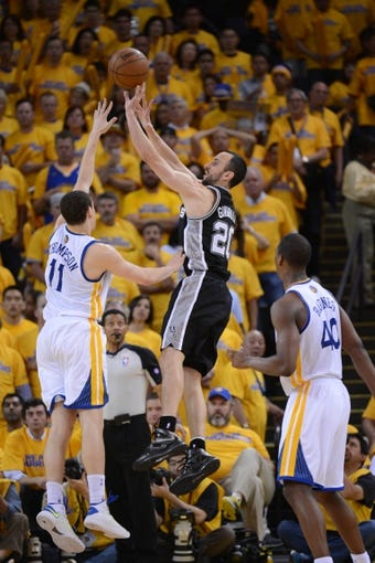 May 12, 2013; Oakland, CA, USA; San Antonio Spurs shooting guard Manu Ginobili (20) shoots the ball over Golden State Warriors shooting guard Klay Thompson (11) during the third quarter in game four of the second round of the 2013 NBA Playoffs at Oracle Arena. The Warriors defeated the Spurs 97-87 in overtime. Mandatory Credit: Kyle Terada-USA TODAY Sports