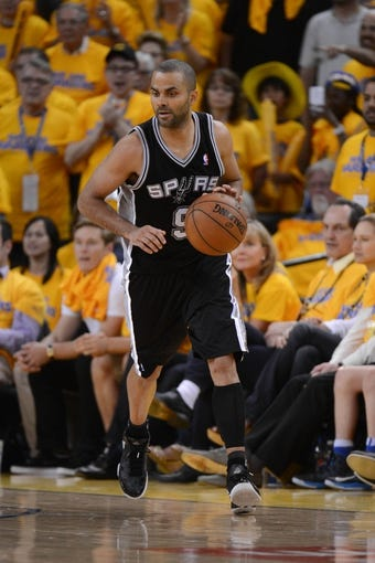 May 12, 2013; Oakland, CA, USA; San Antonio Spurs point guard Tony Parker (9) dribbles the ball during the fourth quarter in game four of the second round of the 2013 NBA Playoffs against the Golden State Warriors at Oracle Arena. The Warriors defeated the Spurs 97-87 in overtime. Mandatory Credit: Kyle Terada-USA TODAY Sports