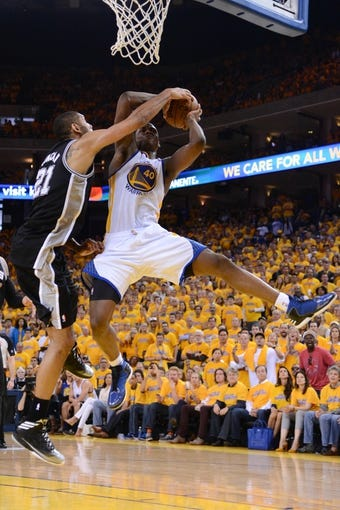 May 12, 2013; Oakland, CA, USA; San Antonio Spurs power forward Tim Duncan (21) blocks the shot of Golden State Warriors small forward Harrison Barnes (40) during the fourth quarter in game four of the second round of the 2013 NBA Playoffs at Oracle Arena. The Warriors defeated the Spurs 97-87 in overtime. Mandatory Credit: Kyle Terada-USA TODAY Sports
