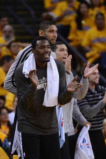 May 12, 2013; Oakland, CA, USA; San Antonio Spurs center DeJuan Blair (45) celebrates during the fourth quarter in game four of the second round of the 2013 NBA Playoffs against the Golden State Warriors at Oracle Arena. The Warriors defeated the Spurs 97-87 in overtime. Mandatory Credit: Kyle Terada-USA TODAY Sports