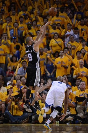 May 12, 2013; Oakland, CA, USA; San Antonio Spurs point guard Tony Parker (9) shoots the ball during the fourth quarter in game four of the second round of the 2013 NBA Playoffs against the Golden State Warriors at Oracle Arena. The Warriors defeated the Spurs 97-87 in overtime. Mandatory Credit: Kyle Terada-USA TODAY Sports