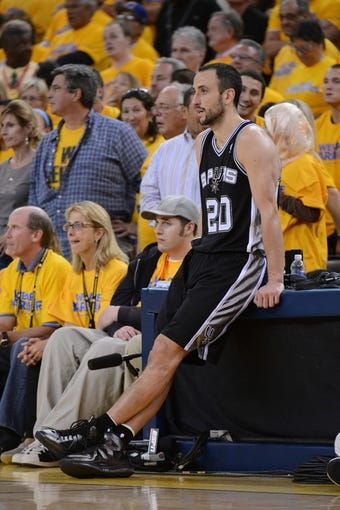 May 12, 2013; Oakland, CA, USA; San Antonio Spurs shooting guard Manu Ginobili (20) rests between plays during overtime in game four of the second round of the 2013 NBA Playoffs against the Golden State Warriors at Oracle Arena. The Warriors defeated the Spurs 97-87 in overtime. Mandatory Credit: Kyle Terada-USA TODAY Sports