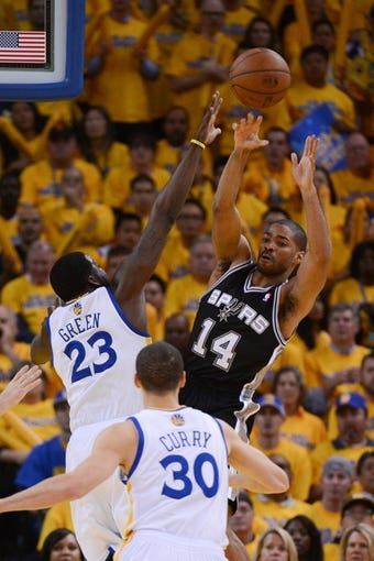 May 10, 2013; Oakland, CA, USA; San Antonio Spurs point guard Gary Neal (14) passes the ball during the fourth quarter in game three of the second round of the 2013 NBA Playoffs against the Golden State Warriors at Oracle Arena. The Spurs defeated the Warriors 102-92. Mandatory Credit: Kyle Terada-USA TODAY Sports