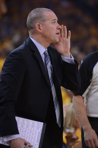 May 10, 2013; Oakland, CA, USA; Golden State Warriors assistant coach Michael Malone instructs during the first quarter in game three of the second round of the 2013 NBA Playoffs against the San Antonio Spurs at Oracle Arena. The Spurs defeated the Warriors 102-92. Mandatory Credit: Kyle Terada-USA TODAY Sports