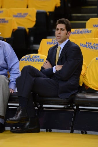 May 10, 2013; Oakland, CA, USA; Golden State Warriors general manager Bob Myers watches warm ups before game three of the second round of the 2013 NBA Playoffs against the San Antonio Spurs at Oracle Arena. The Spurs defeated the Warriors 102-92. Mandatory Credit: Kyle Terada-USA TODAY Sports