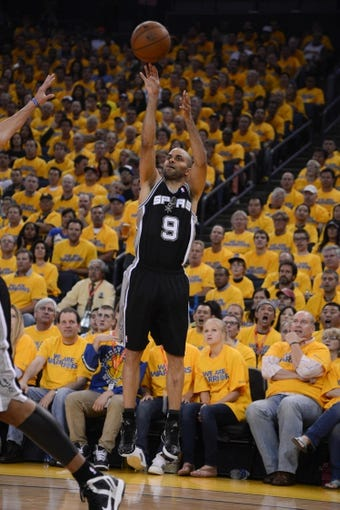 May 10, 2013; Oakland, CA, USA; San Antonio Spurs point guard Tony Parker (9) shoots the ball during the first quarter in game three of the second round of the 2013 NBA Playoffs against the Golden State Warriors at Oracle Arena. The Spurs defeated the Warriors 102-92. Mandatory Credit: Kyle Terada-USA TODAY Sports