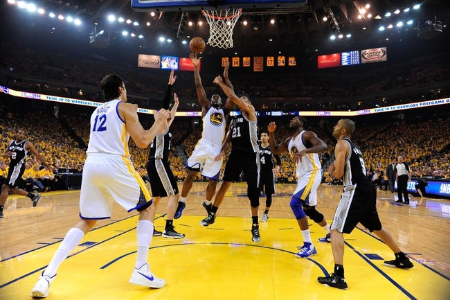 May 10, 2013; Oakland, CA, USA; Golden State Warriors small forward Harrison Barnes (40) shoots the ball against San Antonio Spurs power forward Tim Duncan (21) during the first quarter in game three of the second round of the 2013 NBA Playoffs at Oracle Arena. The Spurs defeated the Warriors 102-92. Mandatory Credit: Kyle Terada-USA TODAY Sports