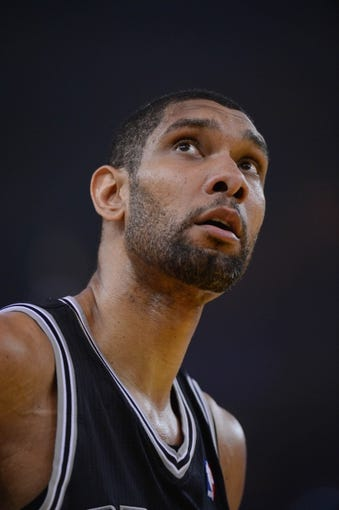 May 10, 2013; Oakland, CA, USA; San Antonio Spurs power forward Tim Duncan (21) reacts during the first quarter in game three of the second round of the 2013 NBA Playoffs against the Golden State Warriors at Oracle Arena. The Spurs defeated the Warriors 102-92. Mandatory Credit: Kyle Terada-USA TODAY Sports