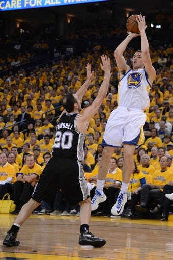 May 10, 2013; Oakland, CA, USA; Golden State Warriors shooting guard Klay Thompson (11) shoots the ball over San Antonio Spurs shooting guard Manu Ginobili (20) during the third quarter of game three of the second round of the 2013 NBA Playoffs at Oracle Arena. The Spurs defeated the Warriors 102-92. Mandatory Credit: Kyle Terada-USA TODAY Sports