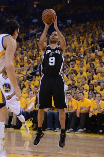 May 10, 2013; Oakland, CA, USA; San Antonio Spurs point guard Tony Parker (9) shoots the ball during the second quarter in game three of the second round of the 2013 NBA Playoffs against the Golden State Warriors at Oracle Arena. The Spurs defeated the Warriors 102-92. Mandatory Credit: Kyle Terada-USA TODAY Sports