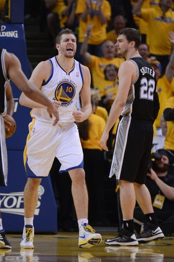 May 10, 2013; Oakland, CA, USA; Golden State Warriors power forward David Lee (10) celebrates during the second quarter in game three of the second round of the 2013 NBA Playoffs against the San Antonio Spurs at Oracle Arena. The Spurs defeated the Warriors 102-92. Mandatory Credit: Kyle Terada-USA TODAY Sports