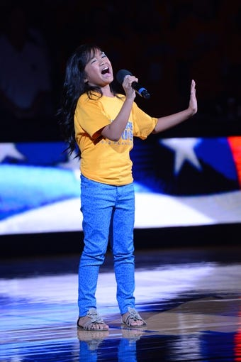 May 10, 2013; Oakland, CA, USA; 8-year old Nayah Damasen sings the national anthem before game three of the second round of the 2013 NBA Playoffs between the Golden State Warriors and the San Antonio Spurs at Oracle Arena. The Spurs defeated the Warriors 102-92. Mandatory Credit: Kyle Terada-USA TODAY Sports