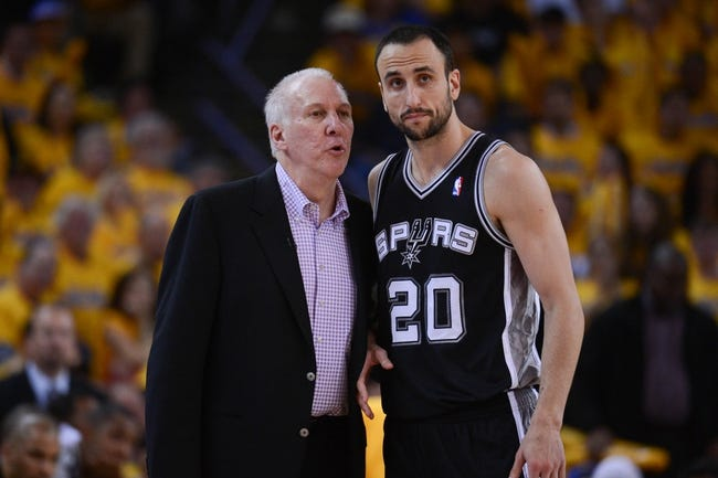 May 10, 2013; Oakland, CA, USA; San Antonio Spurs head coach Gregg Popovich (left) instructs shooting guard Manu Ginobili (20) during the fourth quarter in game three of the second round of the 2013 NBA Playoffs against the Golden State Warriors at Oracle Arena. The Spurs defeated the Warriors 102-92. Mandatory Credit: Kyle Terada-USA TODAY Sports