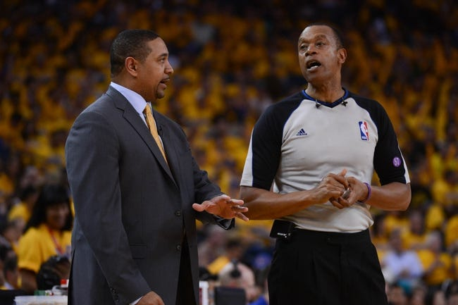 May 10, 2013; Oakland, CA, USA; Golden State Warriors head coach Mark Jackson (left) argues with NBA referee Rodney Mott (71, right) during the third quarter of game three of the second round of the 2013 NBA Playoffs against the San Antonio Spurs at Oracle Arena. The Spurs defeated the Warriors 102-92. Mandatory Credit: Kyle Terada-USA TODAY Sports