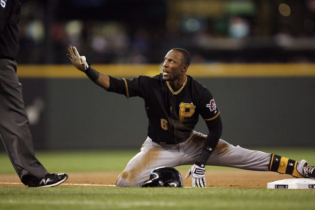 Jun 25, 2013; Seattle, WA, USA; Pittsburgh Pirates left fielder Starling Marte (6) calls for time after sliding safely for a triple against the Seattle Mariners during the first inning at Safeco Field. Mandatory Credit: Joe Nicholson-USA TODAY Sports